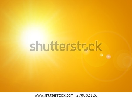 bright sun with lens flare in orange background - stock photo