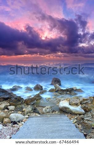 Bright sundown on  sea. Cloud and mist on water - stock photo