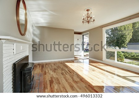 Bright sunny empty living room and entryway interior. Northwest, USA