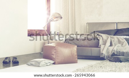 Bright sunny modern bedroom interior with sun flare from a large window and a close up corner view of a rumpled bed, leather pouffe and shoes on the floor. 3d Rendering