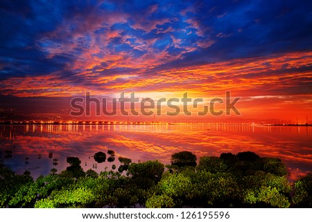 bright sunrise on a river for adv or others purpose use - stock photo