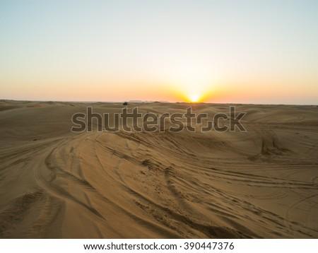 Bright sunset in the Arabian Desert near Dubai - stock photo