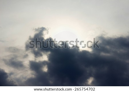 Bright sunset in the sky before a thunder-storm - stock photo