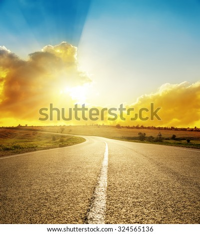bright sunset over road - stock photo