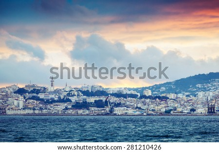 Bright sunset sky over Tangier city, Morocco, Africa. Colorful vintage photo filter effect, instagram style - stock photo