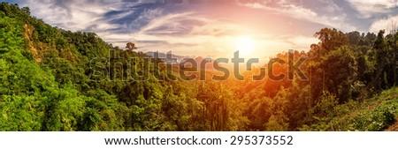Bright Sunset with Panoramic view over Kao Sok Lush Rainforests, Thailand - stock photo