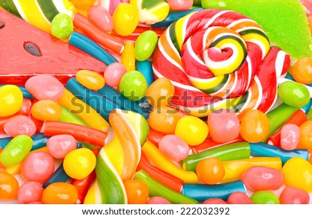 Bright sweets, lollipops, dragee, candies and jelly sweets - stock photo