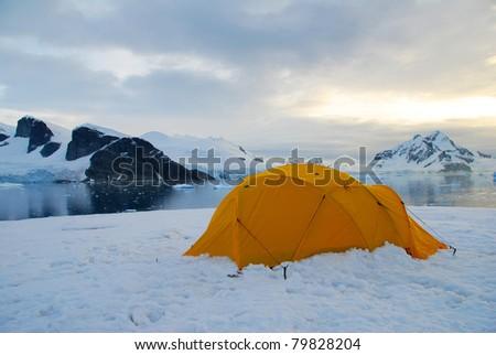 bright tent in snowy antarctic peninsula - stock photo