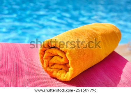 bright towel on a lounger, vacation. - stock photo