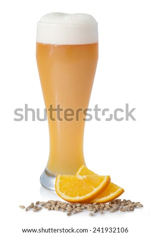 Bright unfiltered beer with foam in the glass on a white background with malt and fruit - stock photo