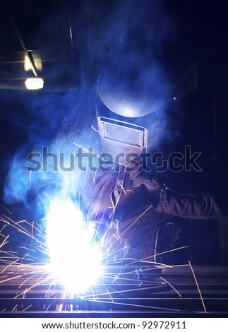 Bright welding and sparks. Construction and production - stock photo