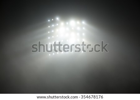 Bright white and yellow Stadium lights with fog