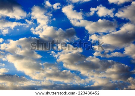 Bright white morning clouds in blue sky - stock photo