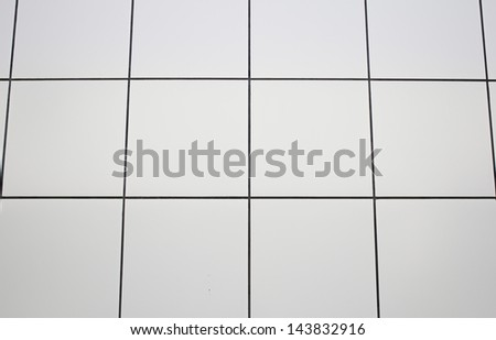 Bright white tile building structure, construction and architecture - stock photo