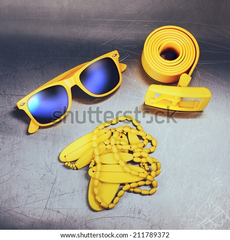 Bright yellow accessories on metal background - stock photo