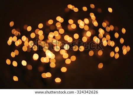 Bright yellow blurred bokeh lights illumination for design element or background - stock photo