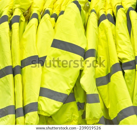 Bright yellow high visibility jackets - stock photo