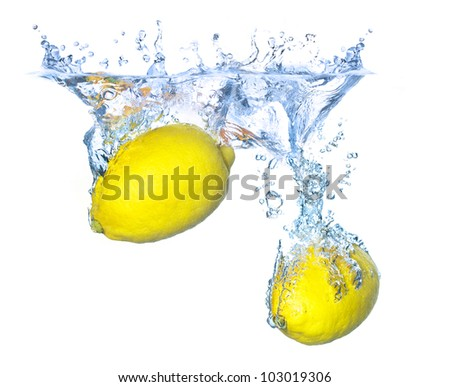 Bright yellow lemons in water. Tasty and healthy food