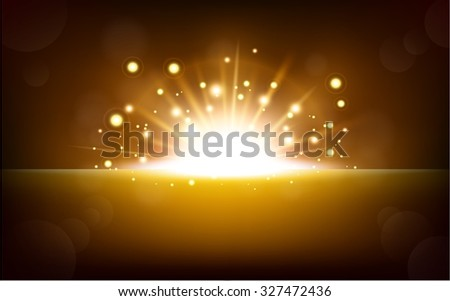 Bright yellow light rising from the black horizon - stock photo