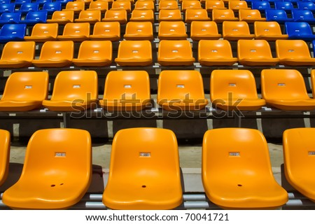 Bright yellow seat rows in stedium at National stedium Thailand. - stock photo