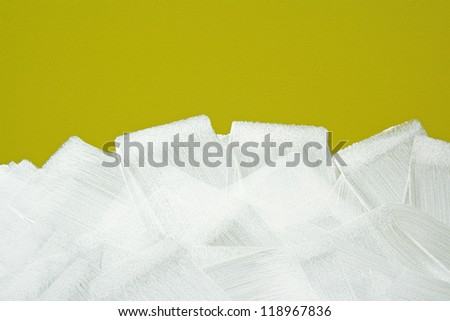 Bright yellow wall painted in white with paint roller. Acrylic paint texture. - stock photo