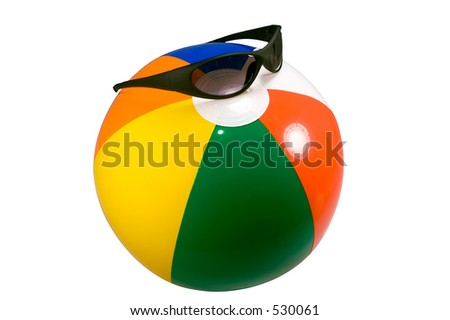 Brightly colored beach ball wearing cool shades isolated against a white background. - stock photo