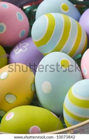 Brightly colored Easter eggs in a basket - stock photo