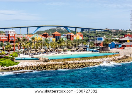 Brightly colored resort hotels on the coast of Curacao