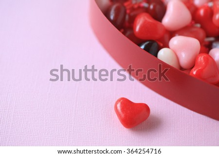 Brightly-colored Valentine candy with sprinkles in a heart box with copy space - stock photo