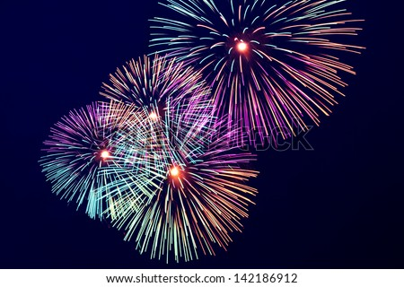 Brightly colorful fireworks and salute of various colors in the night sky - stock photo
