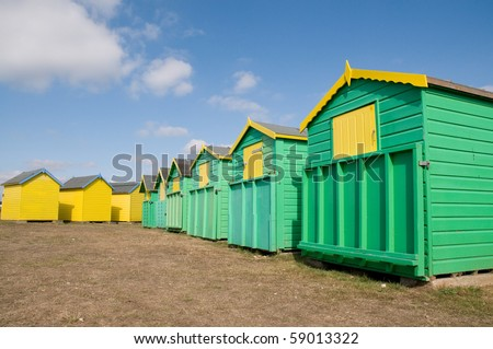 Brightly coloured beach huts on the front at Bognor Regis, Sussex, England