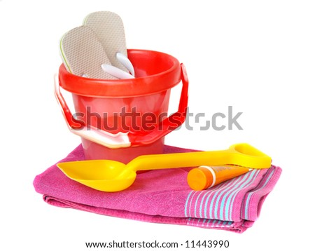 Brightly coloured bucket,spade,towel, sun-cream and flip-flops isolated on white