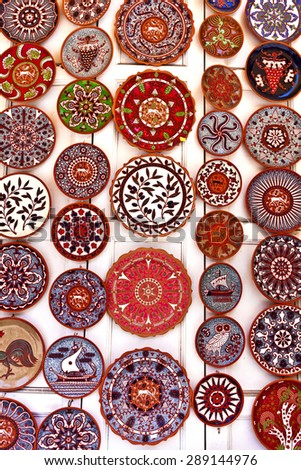 Brightly coloured ceramic plates display. - stock photo
