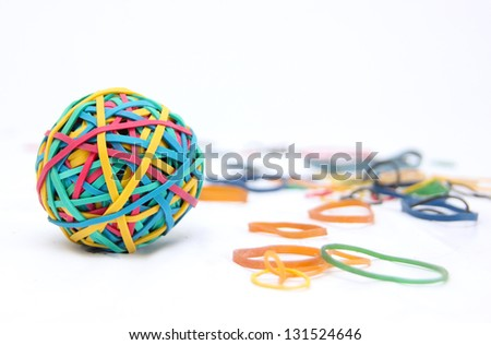 Brightly coloured Rubber band Ball on white background - stock photo