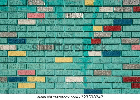 Brightly painted brick wall background texture - stock photo