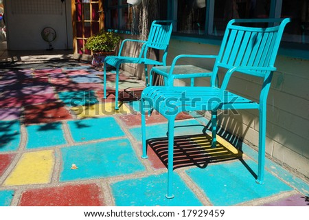 Brightly painted chair; Spanish Village Art Center; Balboa Park; San Diego, California - stock photo