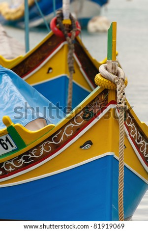 "Brightly painted fishing boats with the ""Eyes of Osiris"" in Marsaxlokk on the island of Malta - stock photo"