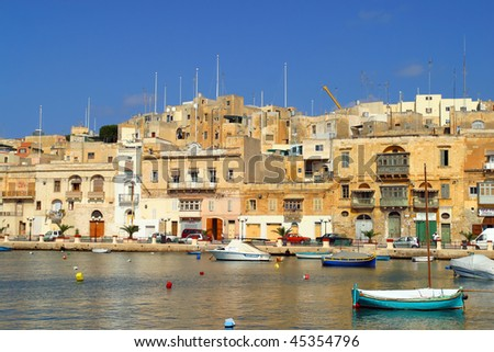 Brightly painted Maltese boats on blue water in summer Malta.
