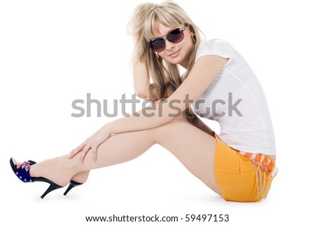 Brightly picture of lovely blonde in sunglasses over white - stock photo