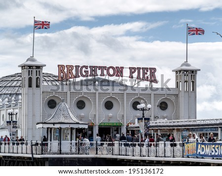 BRIGHTON, EAST SUSSEX/UK - MAY 24 : View of Brighton Pier in Brighton East Sussex on May 24, 2014. Unidentified people.