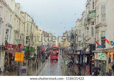 Brighton, England - street scene in the rain - stock photo