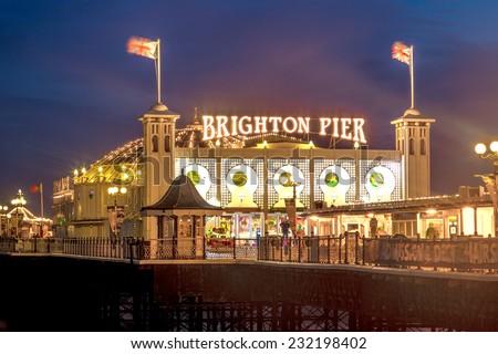Brighton Pier at Night, Sussex, England, UK - stock photo