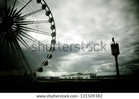 Brighton Pier framed by wheel and old light - stock photo