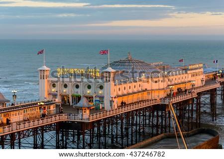 BRIGHTON, UK - CIRCA APRIL 2013: The Brighton Pier at sunset. - stock photo