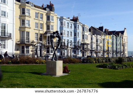 BRIGHTON, UK - MARCH 27: Colorful buildings of Kemp Town  Kemp Town, a dynamic area to the east of Old Steine, stretching as far as Brighton Marina.  Brighton, UK - March 27, 2015 - stock photo