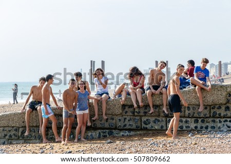 Brighton, UK - September 13, 2016 - A group of teenagers hanging out at Brighton Beach