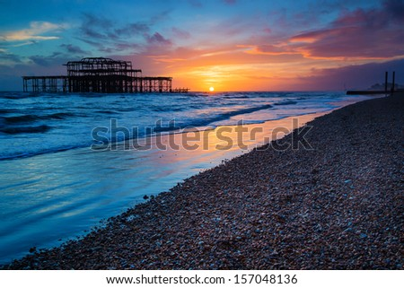 Brighton West Pier at Sunset, Sussex, UK - stock photo