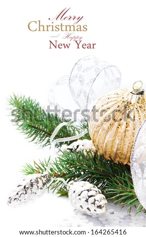 Briight Christmas card with Festive Decorations and Fir Tree branch isolated  on white background close up. Christmas ornaments.Greeting card. (with easy removable sample text) - stock photo