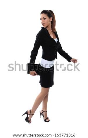 Briliant business girl walking - stock photo