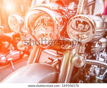 brilliant headlight motorcycle in sunlight - stock photo